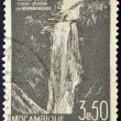 MOZAMBIQUE - CIRCA 1948: A stamp printed in Mozambique, shows Waterfall at Nhanhangare, circa 1948 - Photo