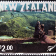 NEW ZEALAND - CIRCA 2001: A stamp printed in New Zeland shows Tramping,  Fiordland National Park, circa 2001 - Photo