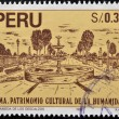 PERU - CIRCA 1992: A stamp printed in Peru dedicated to Lima humanity's cultural heritage, shows the bare Mall (La alamada de los descalzos), circa 1992 — Stock Photo
