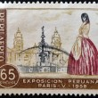 PERU - CIRCA 1958: A stamp printed in Peru dedicated to Peruvian Exhibition Paris shows Peruvian woman in the plaza of the Cathedral of Lima, circa 1958 - Photo