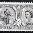 Stock Photo: UNITED KINGDOM - CIRC1964: stamp printed in Great Britain dedicated to Shakespeare Festival, shows Hamlet contemplating Yorick's skull (Hamlet) and Queen Elizabeth II, circ1964