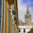 The Giralda of Seville and typical Andalusian houses — Stock Photo