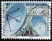 BELGIUM - CIRCA 1971: A stamp printed in Belgium dedicated to telecommunications shows satellite dishes, circa 1971 — Stock Photo