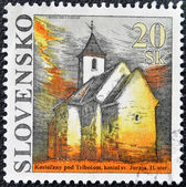 SLOVAKIA - CIRCA 1994: A stamp printed in Slovakia shows St. George Church, circa 2005 — Stok fotoğraf