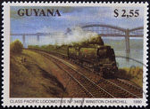 GUYANA - CIRCA 1990: A stamp printed in Guyana shows class pacific locomotive nº 34051 Winston Churchill, circa 1990 — Stock Photo