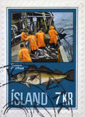 ICELAND - CIRCA 1970: A stamp printed in Iceland shows fishermen and gadus morhua, circa 1970 — Stok fotoğraf