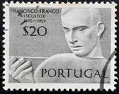 PORTUGAL - CIRCA 1955: Stamp printed in Portugal shows the sculptor Francisco Franco, circa 1955 — Foto de Stock