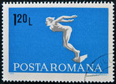 ROMANIA - CIRCA 1969: A stamp printed in Romania shows diving swimmer, circa 1969 — Stock Photo