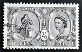 UNITED KINGDOM - CIRCA 1964: A stamp printed in Great Britain dedicated to Shakespeare Festival, shows Hamlet contemplating Yorick's skull (Hamlet) and Queen Elizabeth II, circa 1964 — Stock Photo