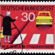 EAST GERMANY - CIRCA 1971: a stamp printed in Germany shows woman at a pedestrian crossing and car, circa 1971 — Stock Photo