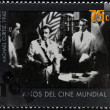 Royalty-Free Stock Photo: ARGENTINA - CIRCA 1995: A stamp printed in Argentina dedicated to 100 years of world cinema shows Casablanca scene of Michael Curtiz, circa 1995