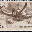 ストック写真: CHIN- CIRC1966: stamp printed in Chinshows paratrooper in fall, circ1966