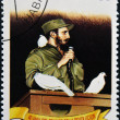 CUBA - CIRCA 1999: A stamp printed in cuba shows Fidel Castro in Havana entrance with a dove perched on her shoulder, circa 1999 — Photo