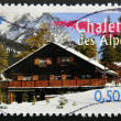 FRANCE - CIRCA 2004: A stamp printed in France shows chalet in the Alps, circa 2004 - Stock Photo