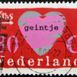 NETHERLANDS - CIRCA 1997: Stamp printed in Holland shows heart with the word joke, circa 1997 - Stock Photo