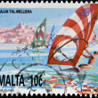 Stock Photo: MALT- CIRC1991: stamp printed in Maltshows windsurfing in MelliehBay, circ1991