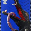 UNITED KINGDOM - CIRCA 2001: A stamp printed in Great Britain dedicated to Punch and Judy shows crocodile, circa 2001 — Stock Photo