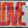 UNITED KINGDOM - CIRCA 2002: A stamp printed in Great Britain shows the word love, circa 2002 — Stock Photo