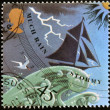 Stock Photo: UNITED KINGDOM - CIRC2001: stamp printed in Great Britain shows image of barometer forecasting rain/stormy weather, circ2001