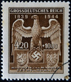 GERMAN REICH - CIRCA 1944: A stamp printed Germany shows eagle and swastika, circa 1944 — Stock Photo