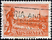 AUSTRALIA - CIRCA 1934: Stamp printed in Australia shows the Yarra Yarra Tribesman, Yarra River and View of Melbourne, Centenary of Victoria, circa 1934 — Stock Photo