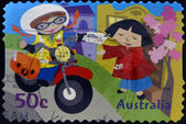 AUSTRALIA - CIRCA 2006: stamp printed in Australia shows Kate On motorcycle, delivering letter, circa 2006 — Stock Photo
