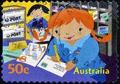 Austrálie - cca 2006: razítko v austrálii ukazuje kate psát adresu na dopis, circa 2006 — Stock fotografie