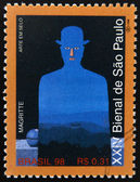 BRAZIL - CIRCA 1998: A stamp printed in Brazil dedicated to Sao Paulo Biennial, shows a work by Rene Magritte, circa 1998 — Stock Photo