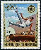 BURUNDI - CIRCA 1972: A stamp printed in Burundi dedicated to the Munich Olympics, shows gymnastic exercise, circa 1972 — Stock Photo