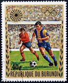 BURUNDI - CIRCA 1972: A stamp printed in Burundi dedicated to the Munich Olympics, shows football, circa 1972 — Stock Photo