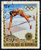 BURUNDI - CIRCA 1972: A stamp printed in Burundi dedicated to the Munich Olympics, shows pole vault, circa 1972 — Stock Photo