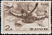 CHINA - CIRCA 1966: A stamp printed in China shows paratrooper in fall, circa 1966 — ストック写真