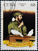 CUBA - CIRCA 1999: A stamp printed in cuba shows Fidel Castro in Havana entrance with a dove perched on her shoulder, circa 1999 — Stock Photo