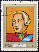 DAVAAR ISLAND - CIRCA 1977: A stamp printed in Davaar Island dedicated to the kings and queens of Britain, shows King George III (1760 - 1820), circa 1977 — Stock Photo