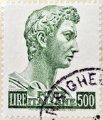 ITALY - CIRCA 1956 : A stamp printed in Italy shows sculpture of St. George by the sculptor Donatello in 1416 for the Church of Orsanmichele, Florence, circa 1956. — Stock Photo