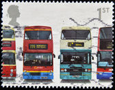 UNITED KINGDOM - CIRCA 2001: A stamp printed in Great Britain shows Daimler Fleetline CRG6LX-33, MCW Metrobus DR102/43, Leyland Olympian ONLXB/1R and Dennis Trident, circa 2001 — Foto Stock