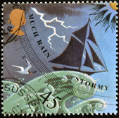 UNITED KINGDOM - CIRCA 2001: a stamp printed in Great Britain shows image of a barometer forecasting rain/stormy weather, circa 2001 — Stock Photo