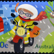 Stockfoto: AUSTRALI- CIRC2006: stamp printed in Australishows Kate On motorcycle, delivering letter, circ2006