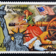 NIGER - CIRCA 1976: stamp printed in Niger shows Statue of Liberty and Molly Pitcher, Heroine of Monmouth, circa 1976 — Stock Photo #19887417