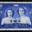 SOUTH AFRICA - CIRCA 1947: A stamp printed in South Africa shows Queen Elizabeth II and her sister, Princess Margaret, Countess of Snowdon, circa 1947 — Stock Photo