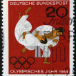 Stock Photo: GERMANY - CIRC1964: stamp printed in Germany shows Struggle of two sportsmen, circ1964.