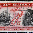 NEW ZEALAND - CIRCA 1940: stamp printed in New Zealand shows a portrait of Captain Cook, the H.M Bark Endeavour and maritime chart of the islands, circa 1940 — Stock Photo #19888547