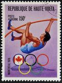 BURKINA FASO - CIRCA 1976: stamp printed in Burkina Faso, shows Olympic emblem and Pole vault, circa 1976 — Stock Photo