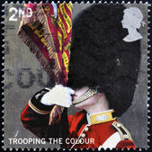 UNITED KINGDOM - CIRCA 2005: A stamp printed in Great Britain shows Ensign of the Scots Guards, trooping the colour, circa 2005 — 图库照片