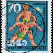"GERMANY - CIRC1970: stamp printed in Germany from ""Voluntary Relief Services"" issue shows rescue from drowning, circ1970. — Foto de stock #21236939"