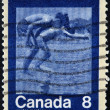 CANADA - CIRCA 1974: A stamp printed in Canada shows Children Diving, circa 1974 — Stock Photo