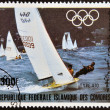 COMORES - CIRCA 1983: A stamp printed in Comores dedicated to the Olympic sailing shows Type 470, circa 1983  — Stock Photo