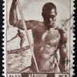 FRENCH EQUATORIAL AFRIC- CIRC1947: stamp printed in former French Equatorial region of Africshows men canoe, circ1947 — Foto de stock #21237451