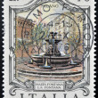 Foto Stock: ITALY - CIRC1975: stamp printed in Italy shows Piazzfountain in Milan, circ1975