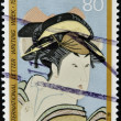 JAPAN - CIRCA 1988: A stamp printed in Japan dedicated to international letter writing week, shows painting of a Japanese woman, circa 1988 — Stock Photo